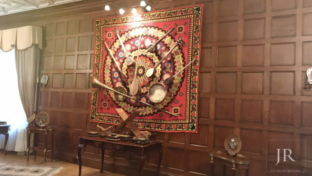 Uzbek musical instruments and carpet decorating wall